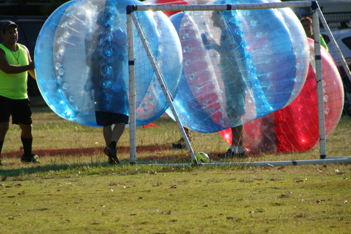 The blue team scored a goal. Instead of jumping, slapping and hugging each other, the best they could manage was a plastic 'shoulder rub' while other team members took a celebratory roll. :)