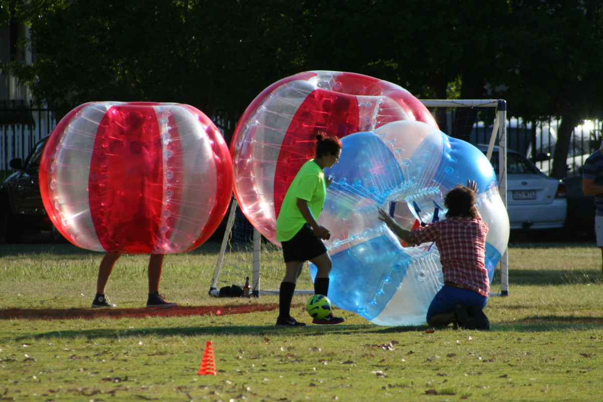 Bubble soccer players need to be comfortably positioned within the bubble and firmly holding the handles before the game begins. There's not much room for readjustment once the player is upright.