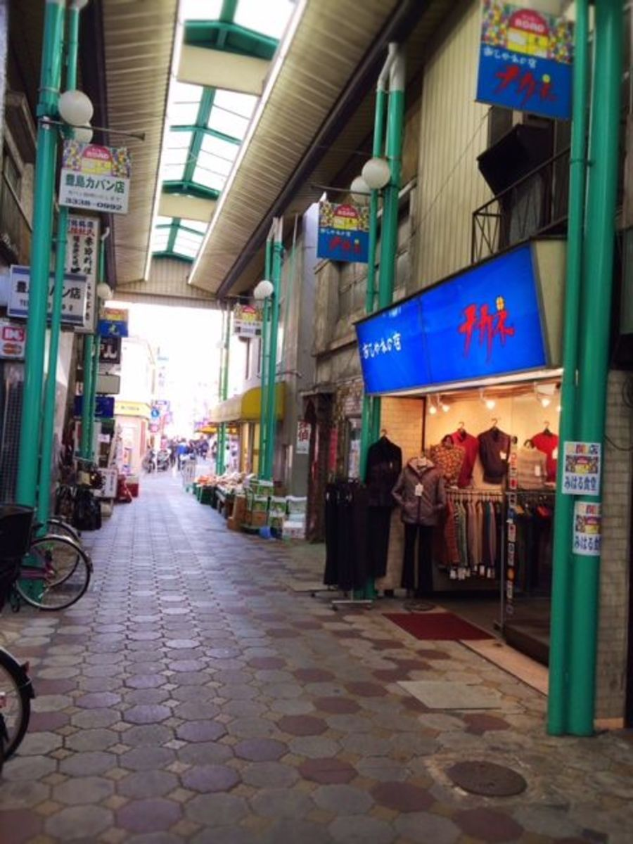 Arcade-style shopping street with tofu shops, crystal store, chiropractic clinic and other randomness.
