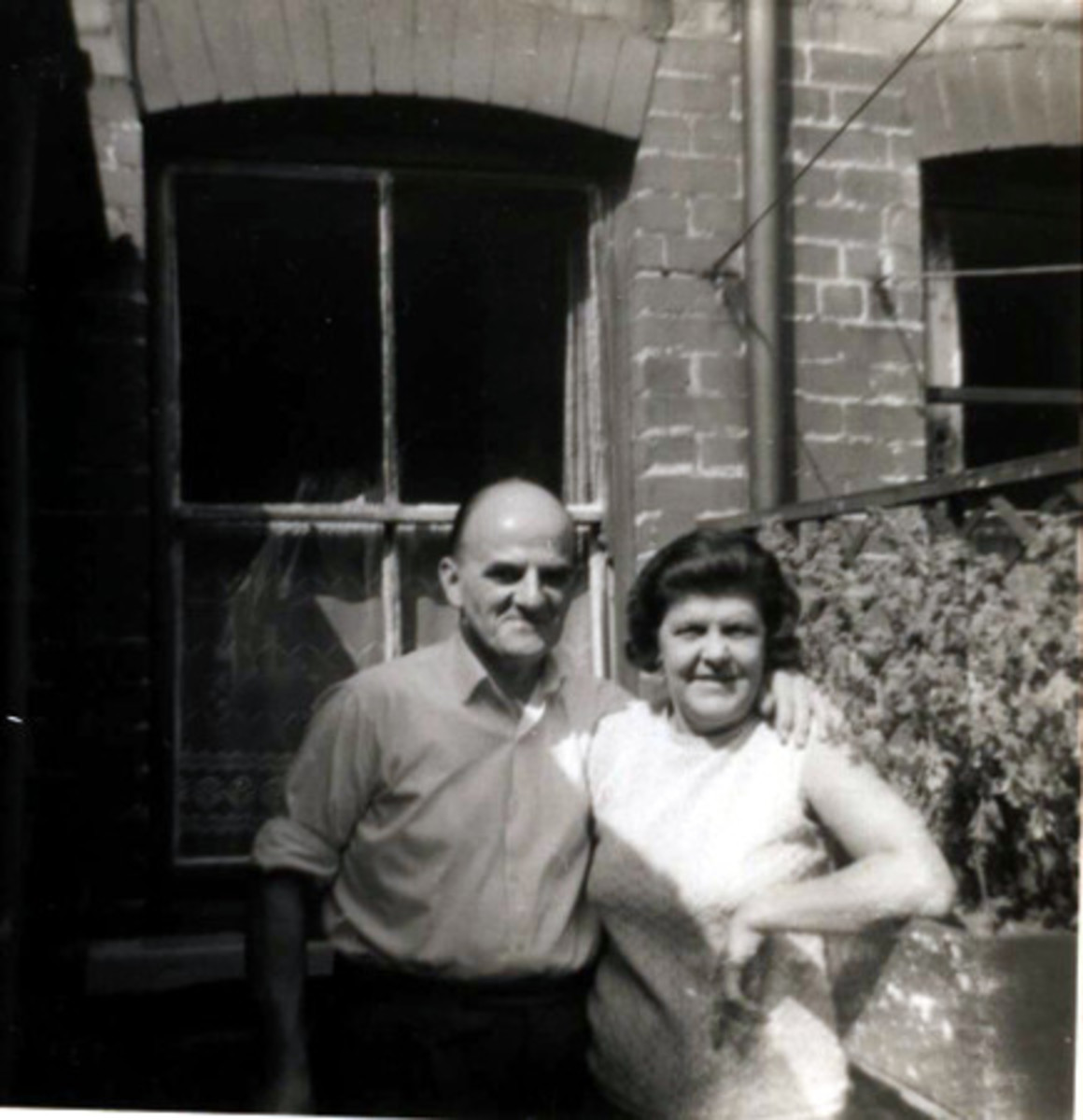 My lovely mam and dad outside the back door