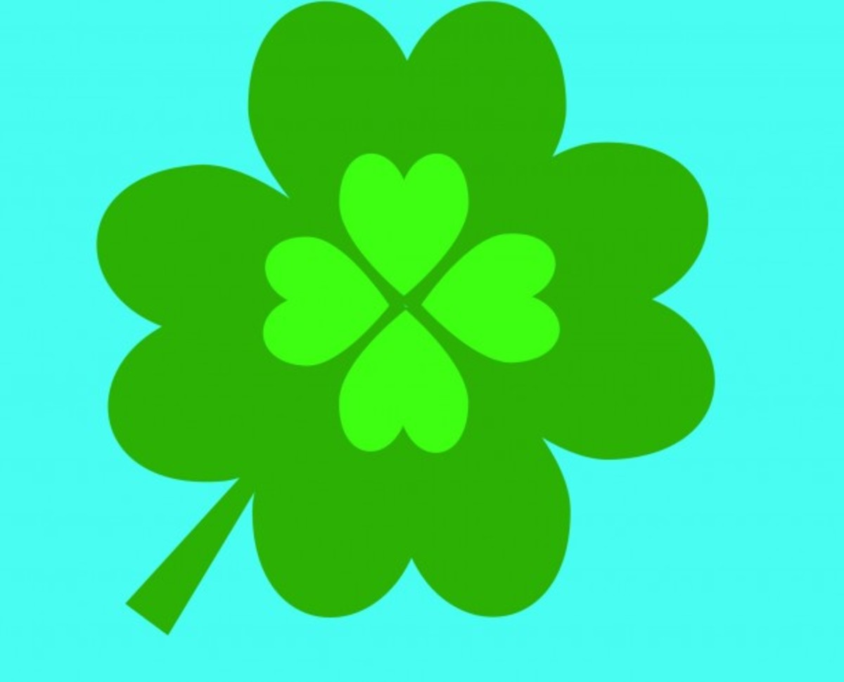 Four-Leaf Clover on Blue Background
