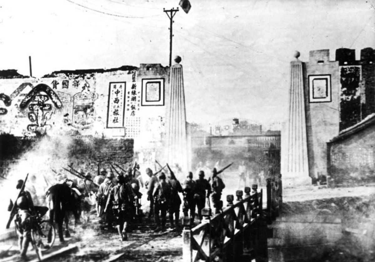Japanese soldiers entering the doomed city of Nanjing in early 1938.