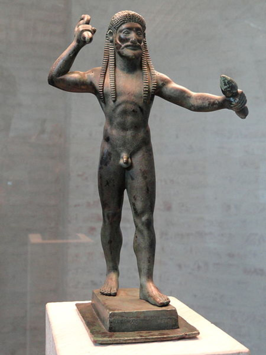 A bronze statuette of Zeus in the Archaic style, showing him wielding the thunderbolt.