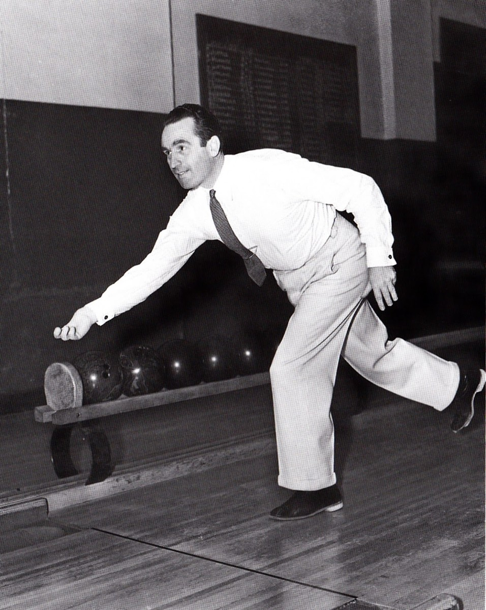 A rare unguarded moment. Harold's deformed right hand can be seen as he goes bowling.