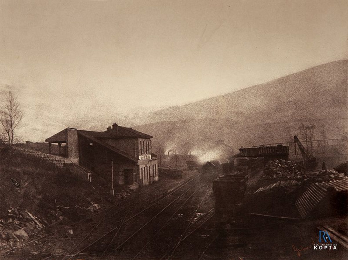 Train station with train and coal depot by Gustave Le Gray.