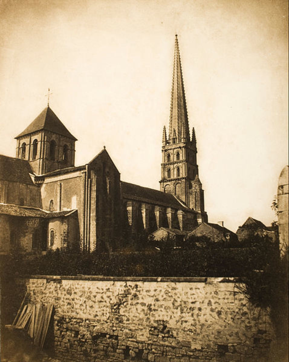 Gustave Le Gray - Saint Savin, (Vienne).  1847/1855.  My eyes were drawn to the texture in the wall to the detail of the steeple on the church.  Salted paper print.