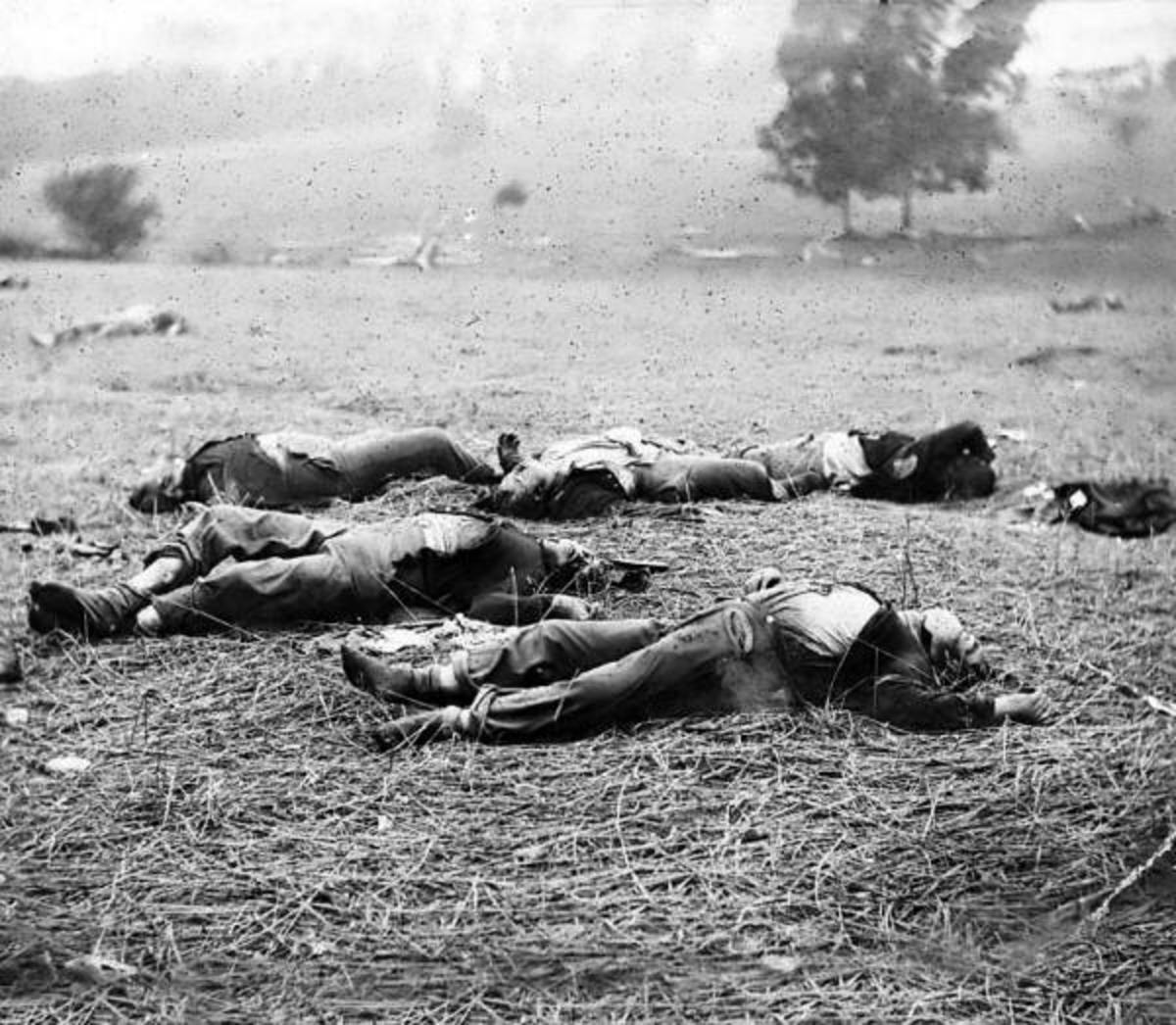 Union dead at Gettysburg, PA. By the time of this photograph, these corpses were on the field for about three days. Note the blackened skin and bloated conditions of the abdomen, limbs, and faces