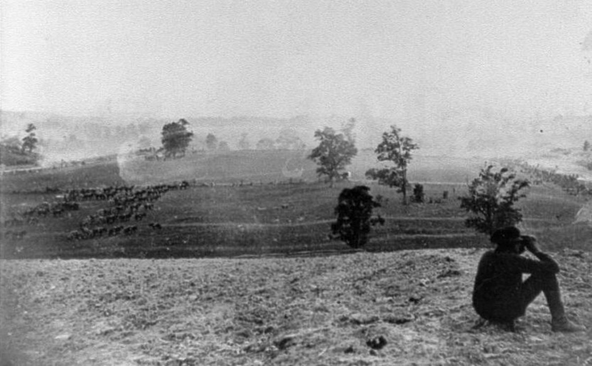 A courier, behind Antietam Creek, scans the battlefield as an artillery battery remains limbered and ready to move