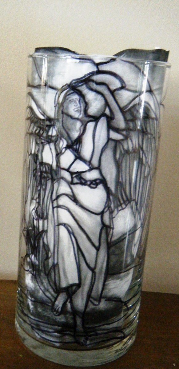 This is a stained glass themed candle holder with the stained glass picture scotch taped to the inside.