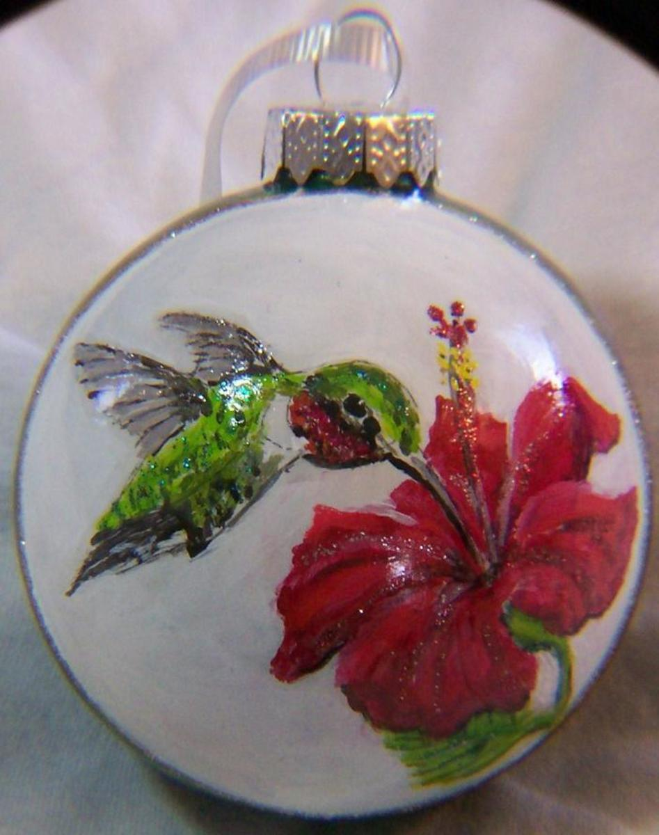http://pelhamartworks.blogspot.com/2013/01/hummingbird-hibiscus-hand-painted-glass.html