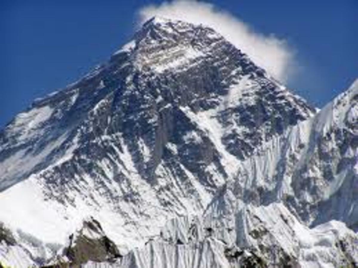 Mt. Everest, the highest mountain on Earth - is situated along the Nepalese-Chinese (Tibet) border and administered by Nepal.