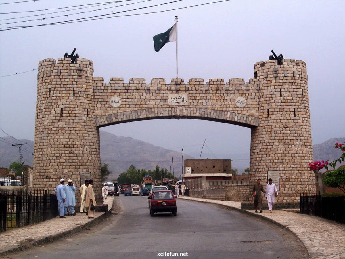 The border crossing between Afghanistan and Pakistan (showing the Pakistan flag) along the world famous Khyber Pass which is also a NATO Supply Route. The Khyber pass also carries the famous Grand Trunk Road which has existed since the 16th Century.