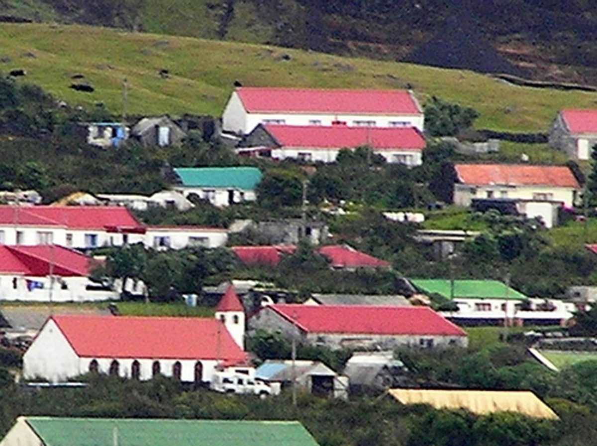 Edinburgh of the Seven Seas - the capital of Tristan da Cunha in the Atlantic Ocean. Located at roughly  37'S and 12'W, Tristan da Cunha is the world's remotest inhabited archipelago and one of the southernmost regions in the world using GMT.