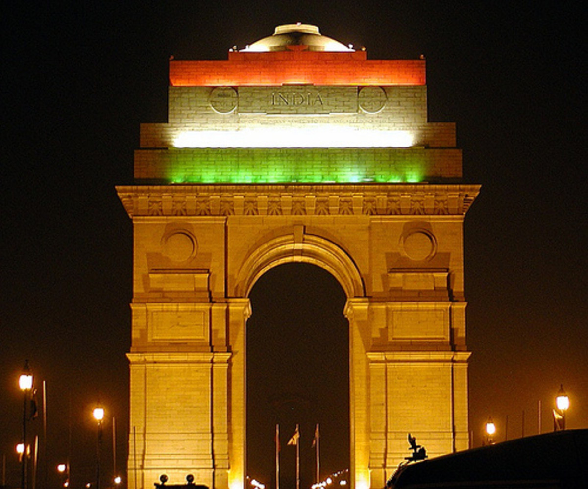 The India Gate Cenotaph (decorated with the Indian flag color scheme) at New Delhi, India.