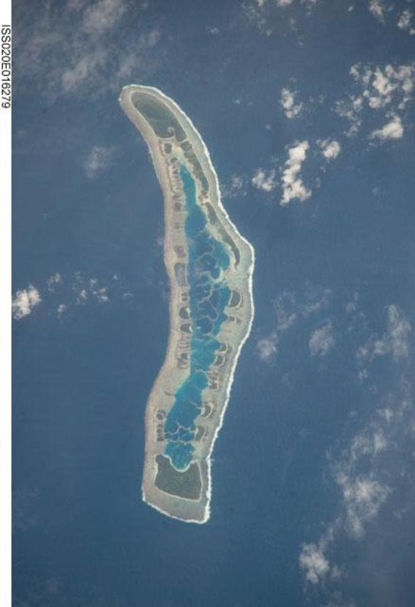 Satellite image of Caroline Island (Line Islands, Kiribati) which at roughly 9 Degrees South and 150 Degrees West, is the easternmost point on Earth (based on its UTC + 14 Time zone)