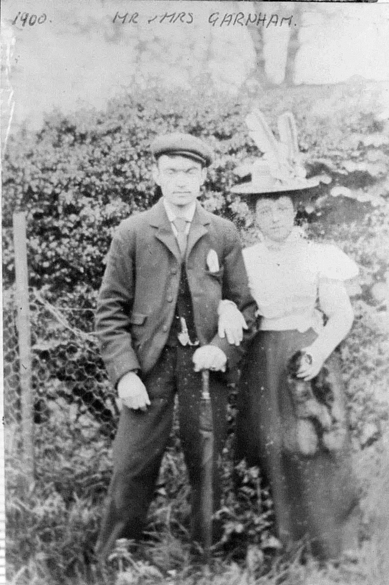 """My grandma Ivy Trigg's parents, Albert and Laura Garnham (nee Tomlinson) in their youth in 1900. I feel this is their wedding day on 4th August, as they are both dressed up and someone has written on it: """"Mr and Mrs Garnham, 1900""""."""