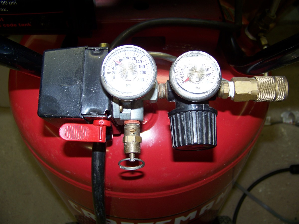The pressure switch is the black box located to the left of the gauges. It turns the compressor motor on and off in order to maintain tank pressure.