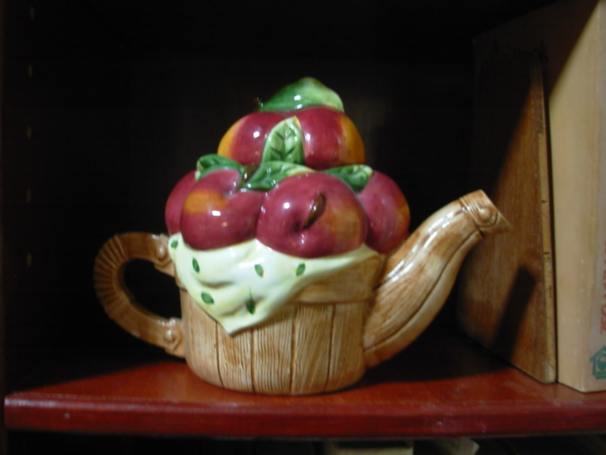 A teapot in the shape of an apple basket.