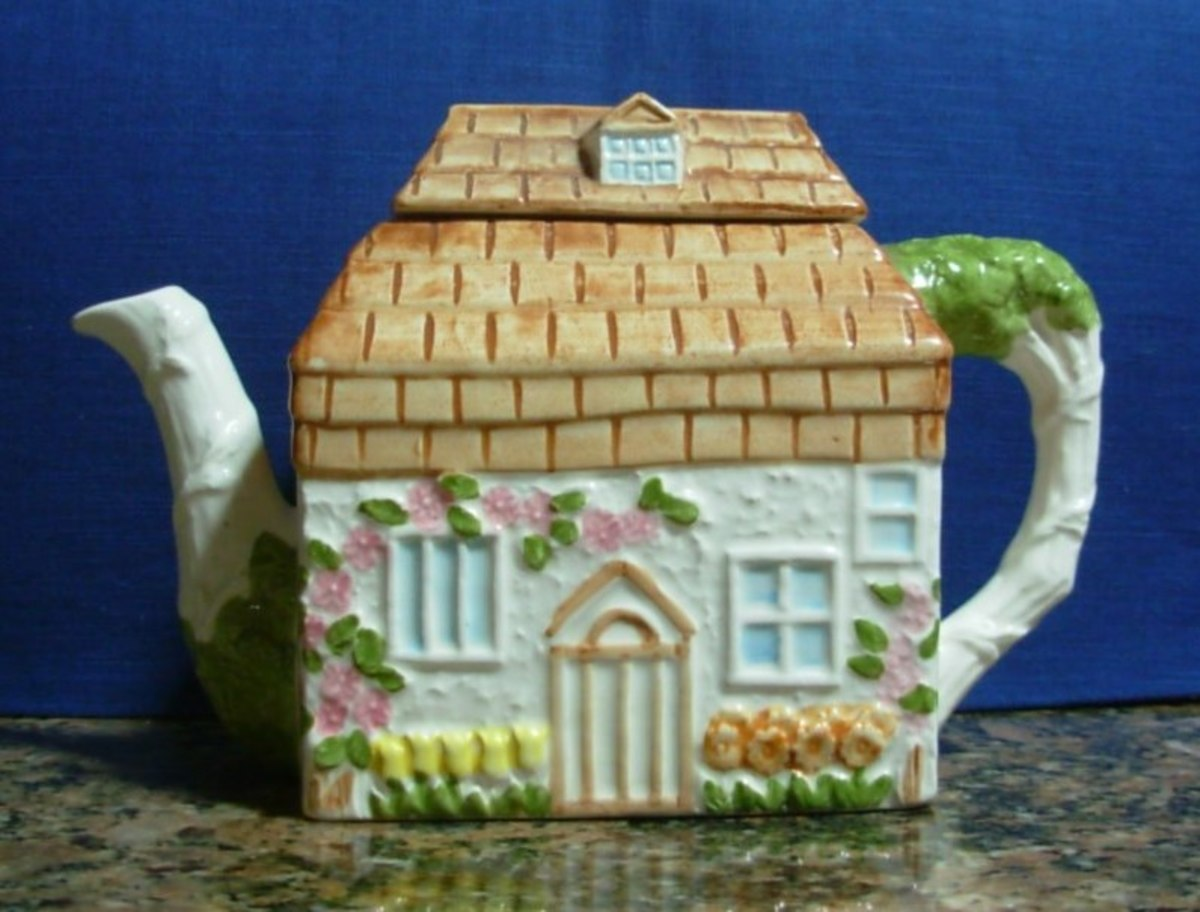 A teapot in the shape of a home.
