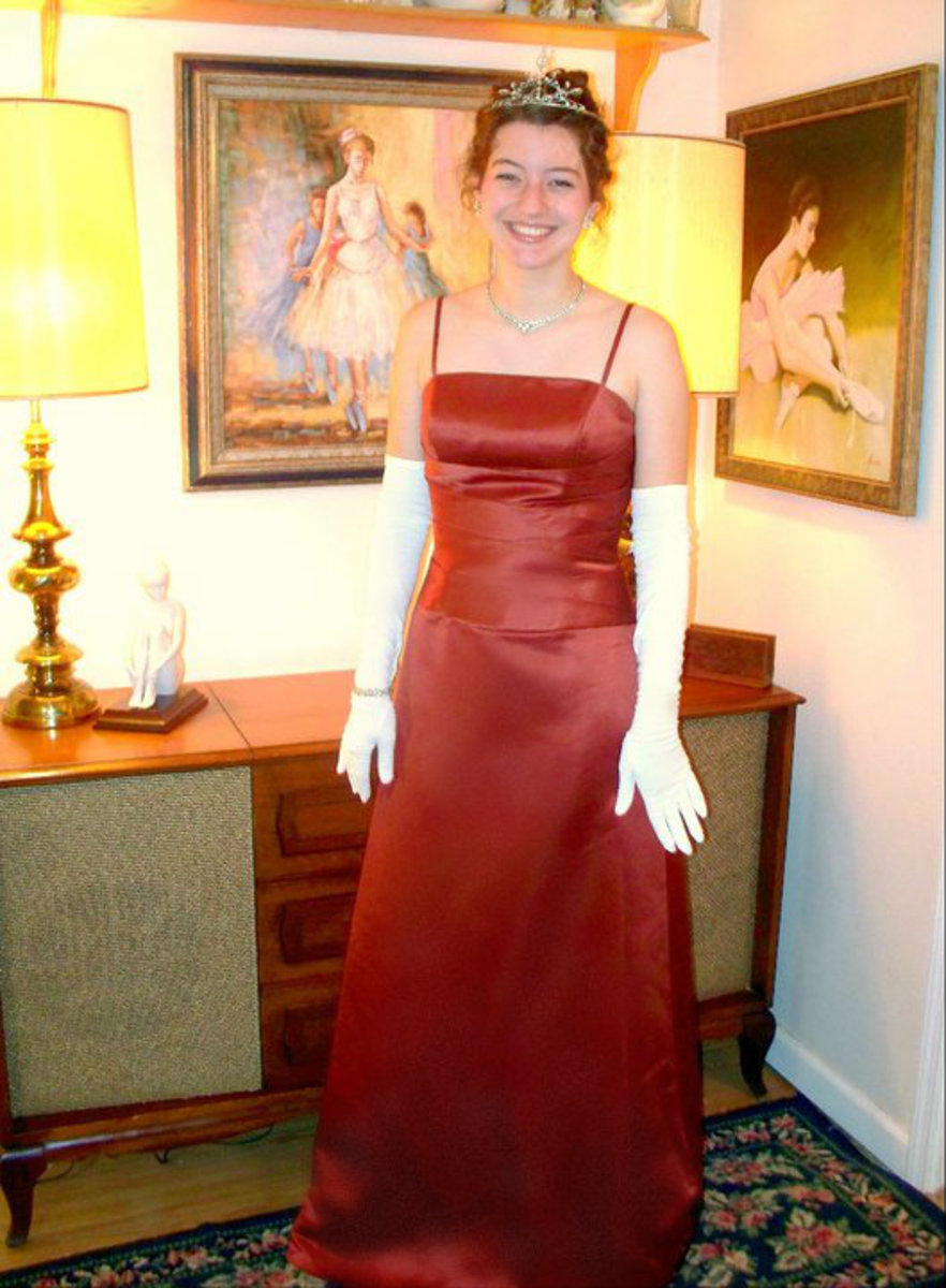 Opera gloves, a tasteful vintage tiara and matching necklace and earrings will really give a beautiful vintage gown the wow effect.