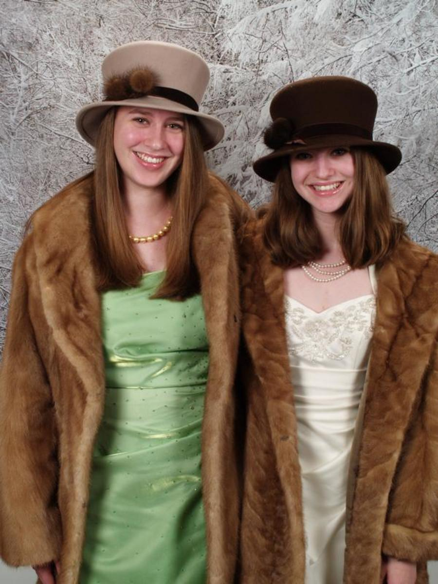 Full length vintage mink coats, and mink car coats look good with hats that are also trimmed with mink. These two hats were made by a furriers and have mink pom pom balls on their rims.