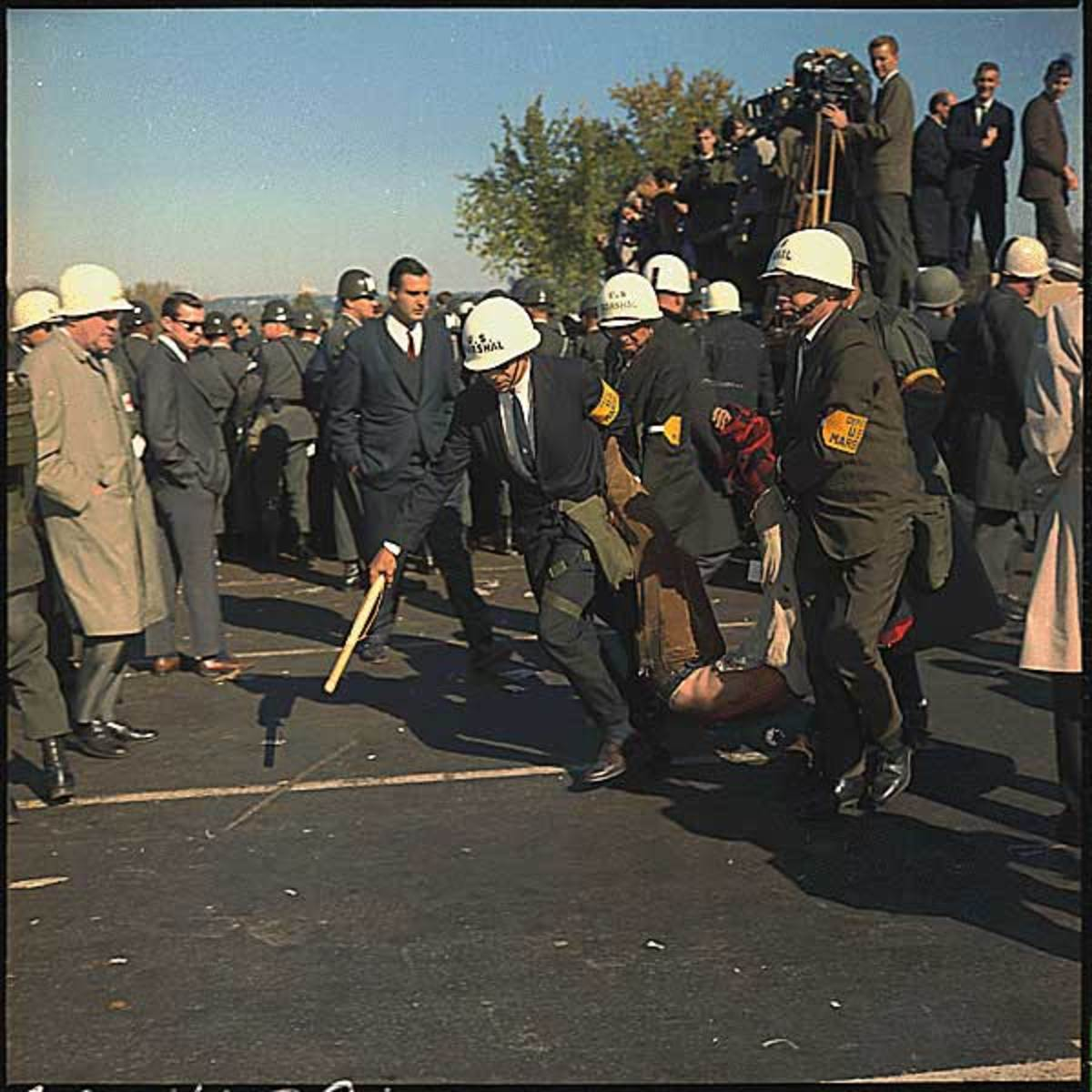 In Washington D.C. An anti-Vietnam demonstration. U.S. Marshals bodily remove one of the protesters during the outbreak of violence at the Pentagon Building, October 1967.