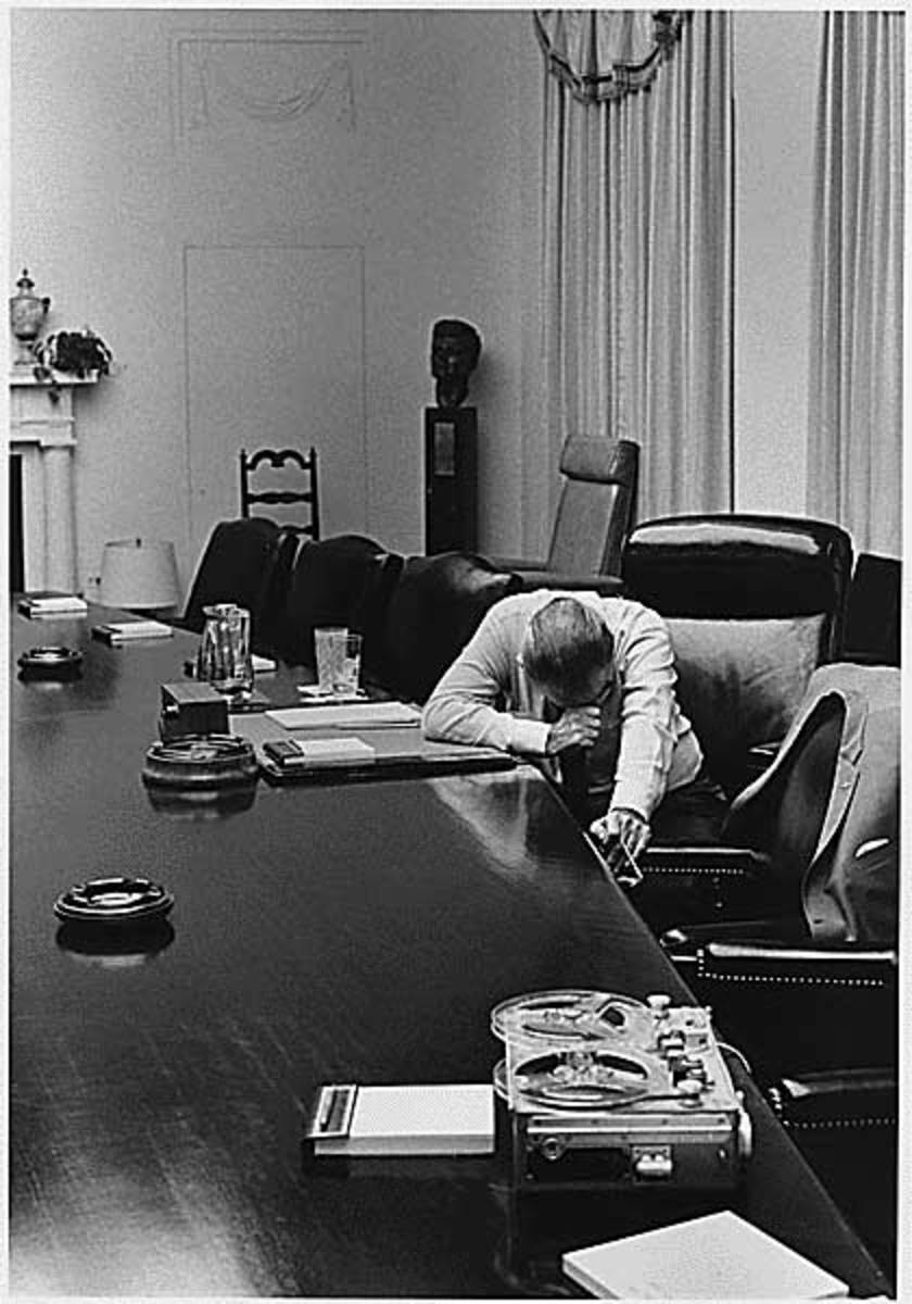 1964 - President Lyndon B. Johnson listens to taped report sent by adviser Captain Charles Robb (his future son-in-law) from Vietnam.