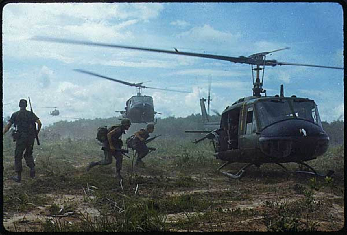 "UH-1D helicopters airlift members of the 2nd Battalion, 14th Infantry Regiment from the Filhol Rubber Plantation area to a new staging area, during Operation ""Wahiawa,"" a search and destroy mission conducted by the 25th Infantry Division"