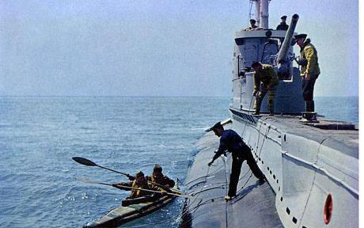 Canoes loading from HMS Tuna