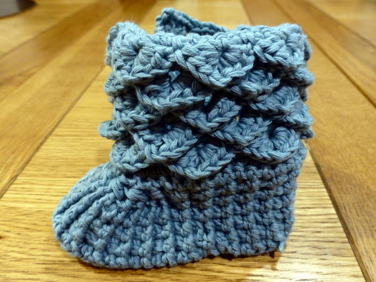 Here is a baby bootie crocheted with scales around the top and all in one color. These booties look so very clever and they are quick and easy to crochet once you get this stitch mastered.