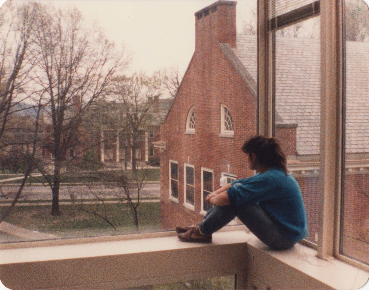 Student enjoying the view looking south from the airy Traylor Art Building, past the Rogers Art Building towards Presser Music Hall.