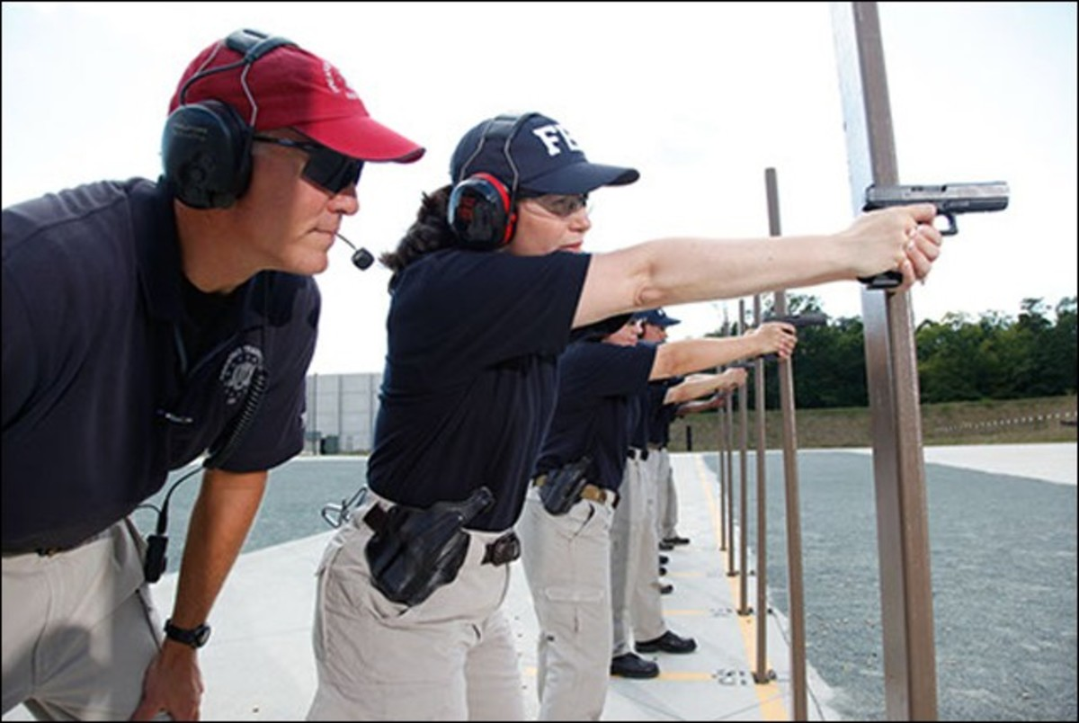 Female FBI Agent Practicing Shooting