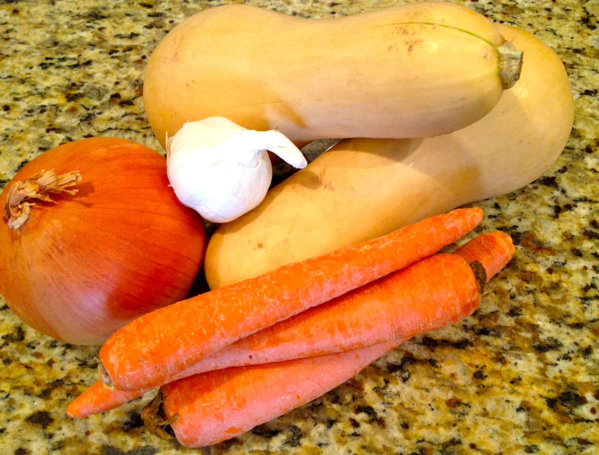 Gather garlic and vegetables to dice and chop.