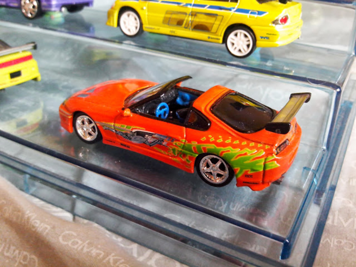 Orange Toyota Supra and Green Mistubishi Evolution used by Brian