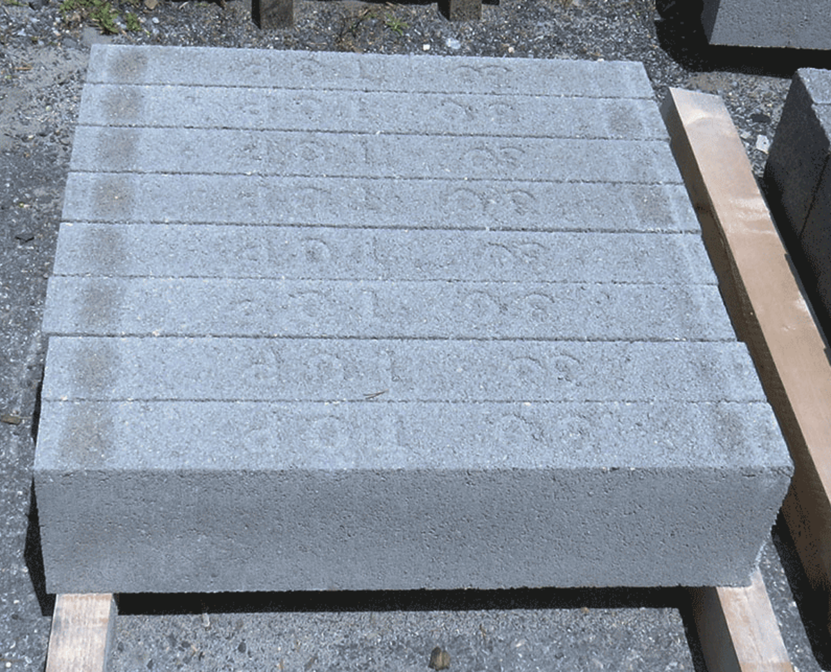 b. Rectangular cement blocks on wood supports.