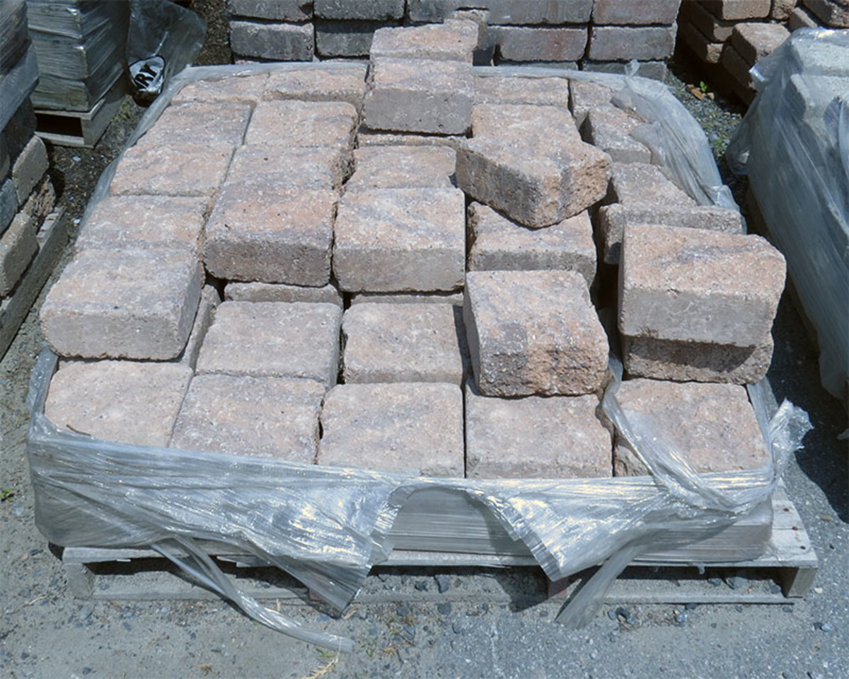 c. Paver squares in plastic packaging.