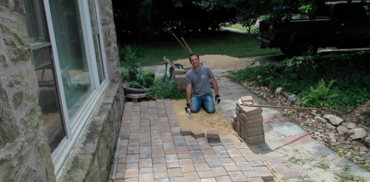 Taking a picture break on my soon-to-be front terrace, with stacks of pavers to the side.