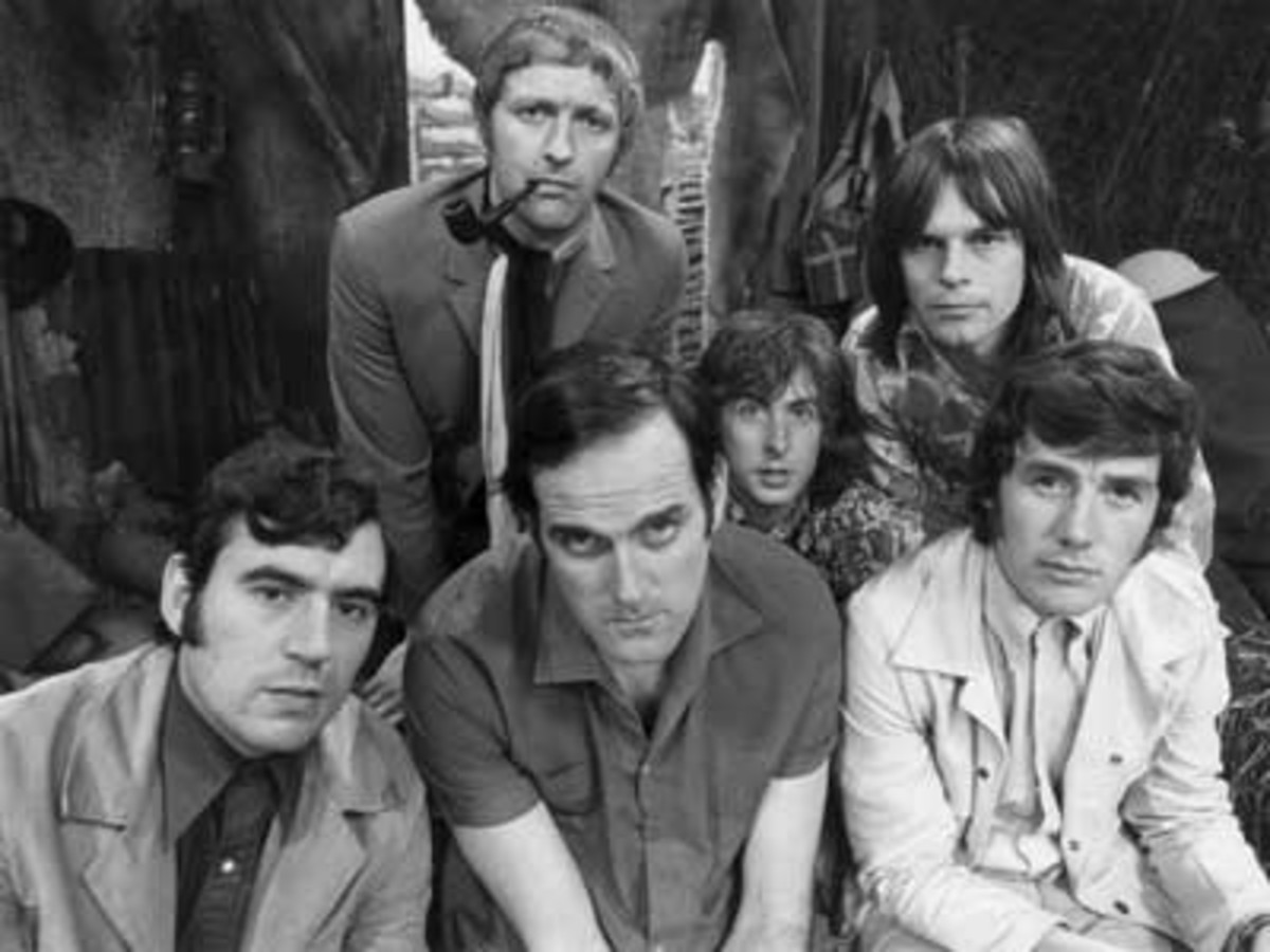 Monty Python 1969. Front (L-R): Terry Jones, John Cleese, Michael Palin. Back (L-R): Graham Chapman (deceased), Eric Idle, Terry Gilliam (American).
