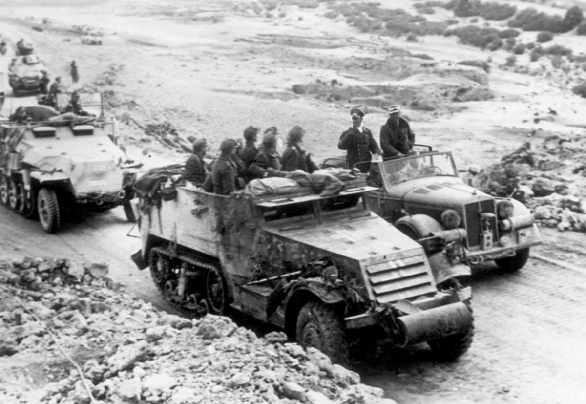 Rommel with his troops in North Africa, in the command car on the right.