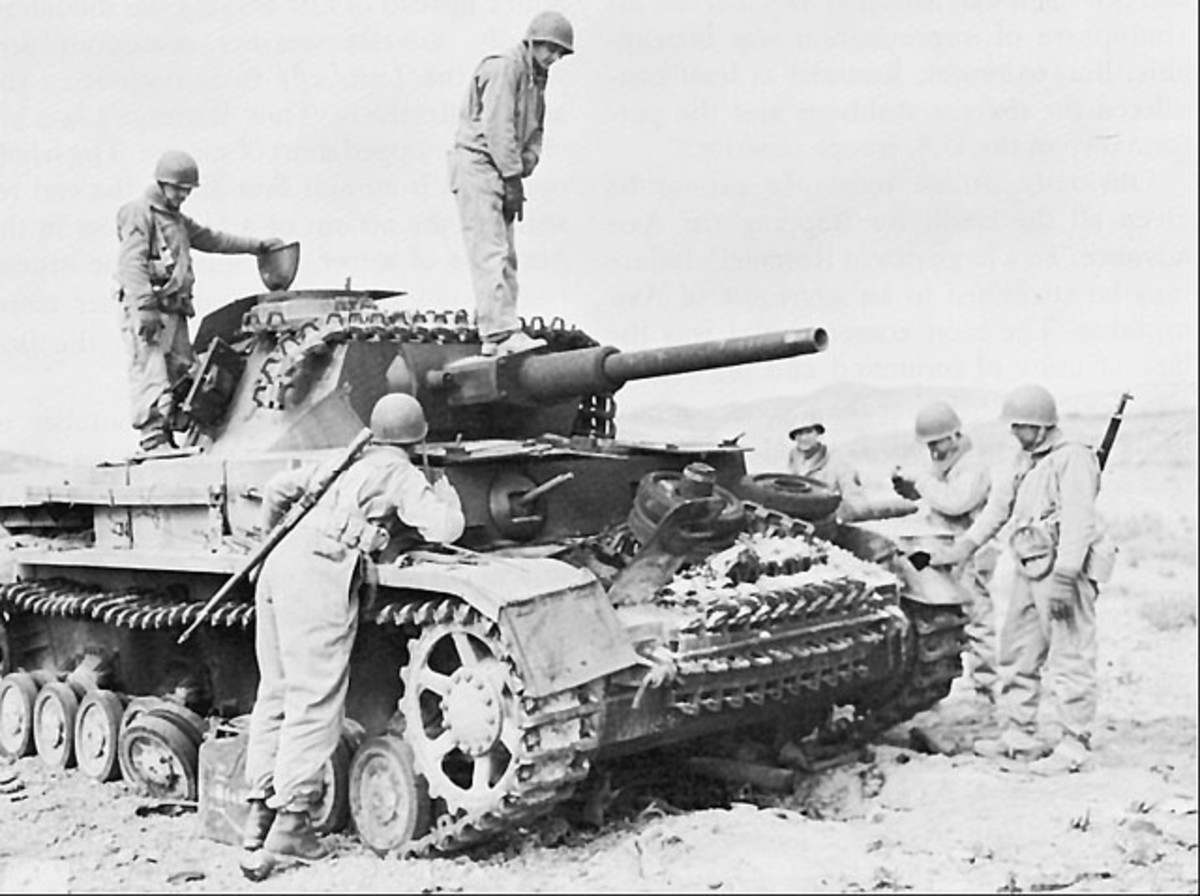 American troops inspect a captured German tank.