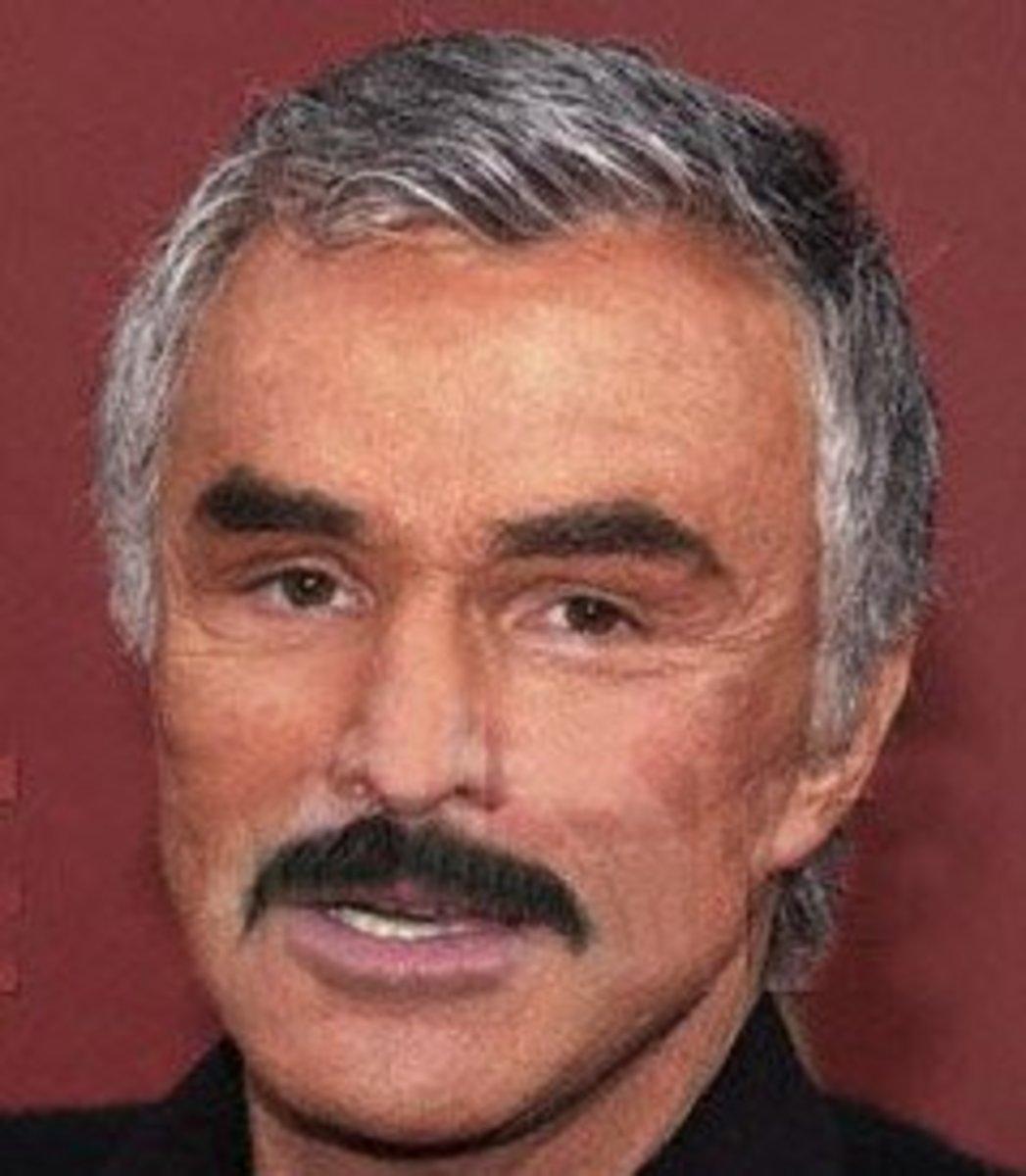 Burt Reynolds with a salt 'n pepper toupee