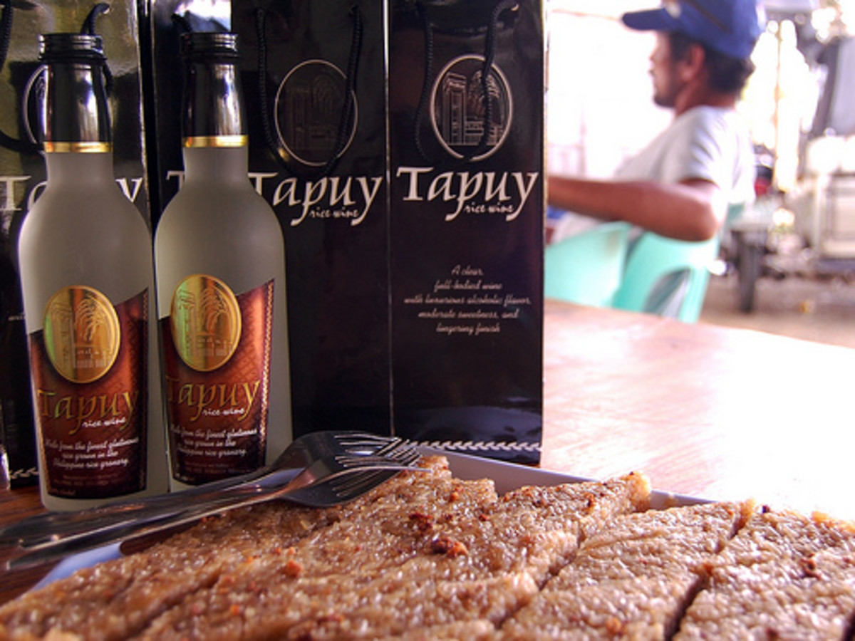 Tapuy - The Ceremonial Rice Wine of the Cordilleras. Sometimes called 'Filipino sake'. Also a perfect beverage for Bico or Sinukmani, a sticky rice cake for snack in the Philippines. (Photo courtesy by ~MVI~ from Flickr.com)