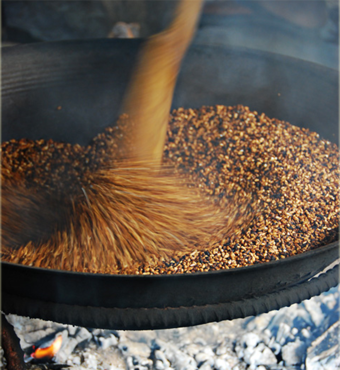 Roasting the rice grains for 30 minutes or until the grains turned to golden brown (Image Credit: AkosiSuperEdwinK from pinoyphotography.org)