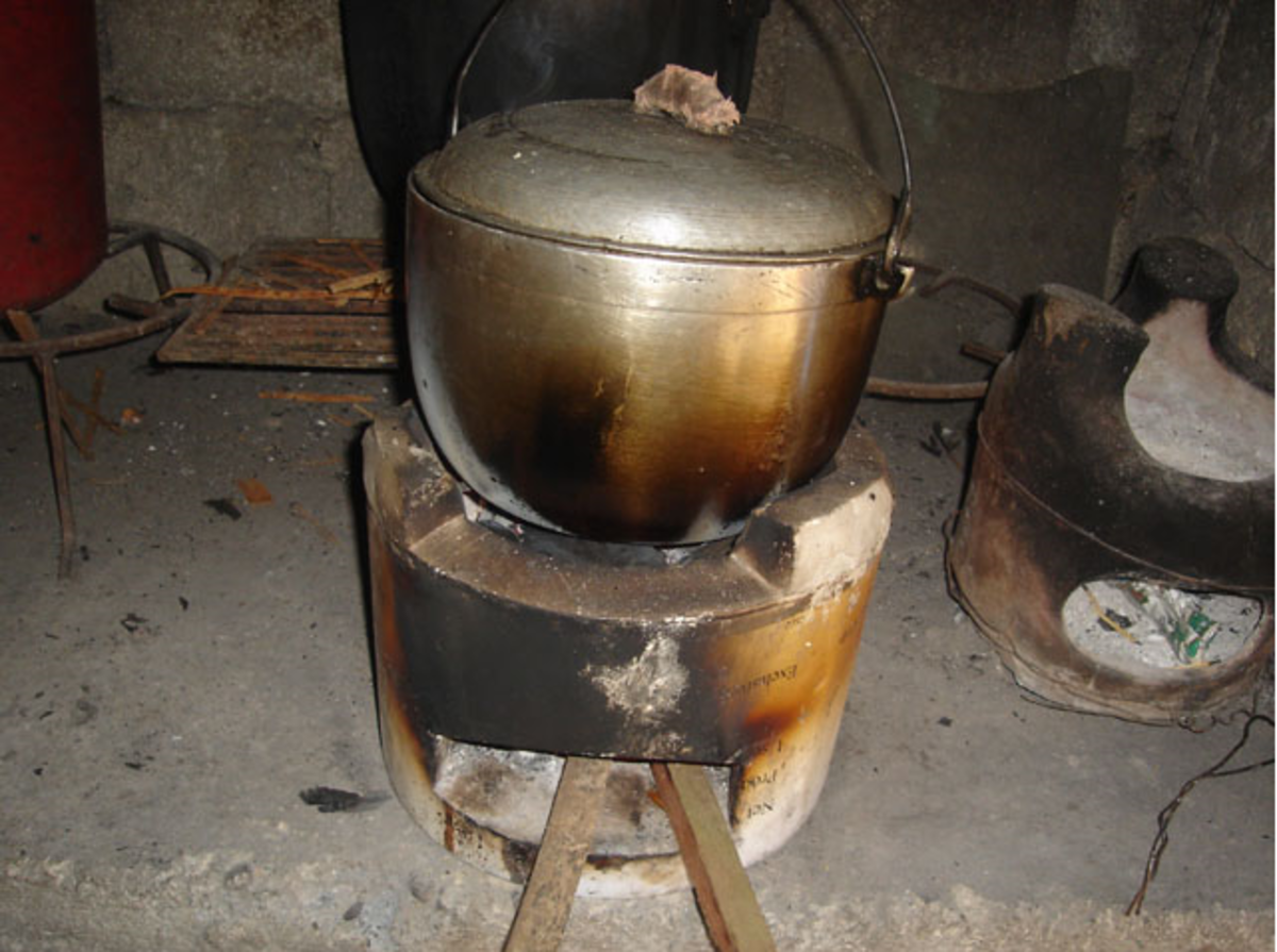 Rice is boiled inside a covered pot with enough amount of water until cooked. (Image Credit: Photos by Jun Verzola and Brenda Dacpano/NORDIS from galleries.nordis.net)
