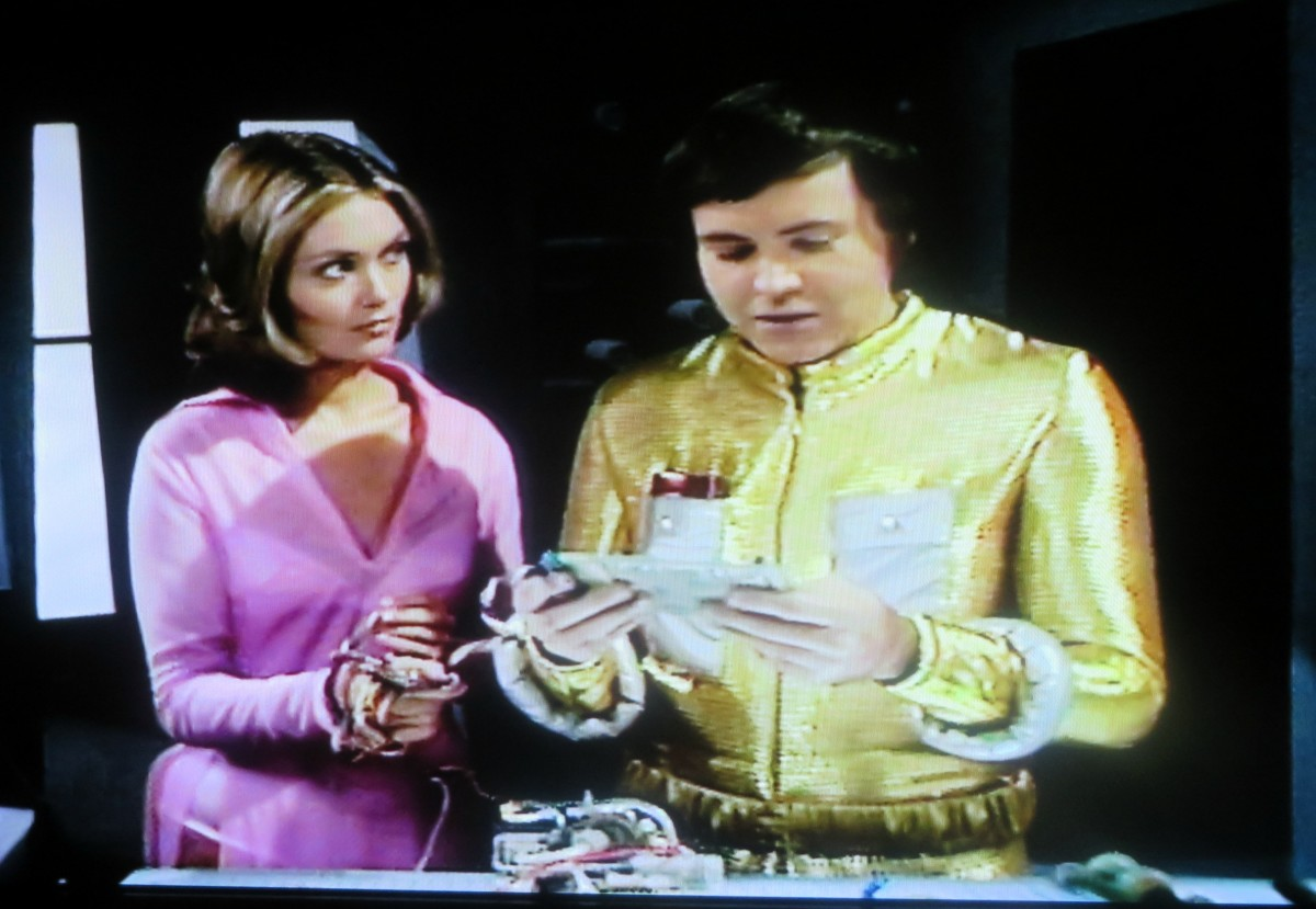 Here is a great photo of the human female from a bio-dome who was named  Edonna and the Alien Oro Played by Walter Koenig. Garth was falling in love with her.