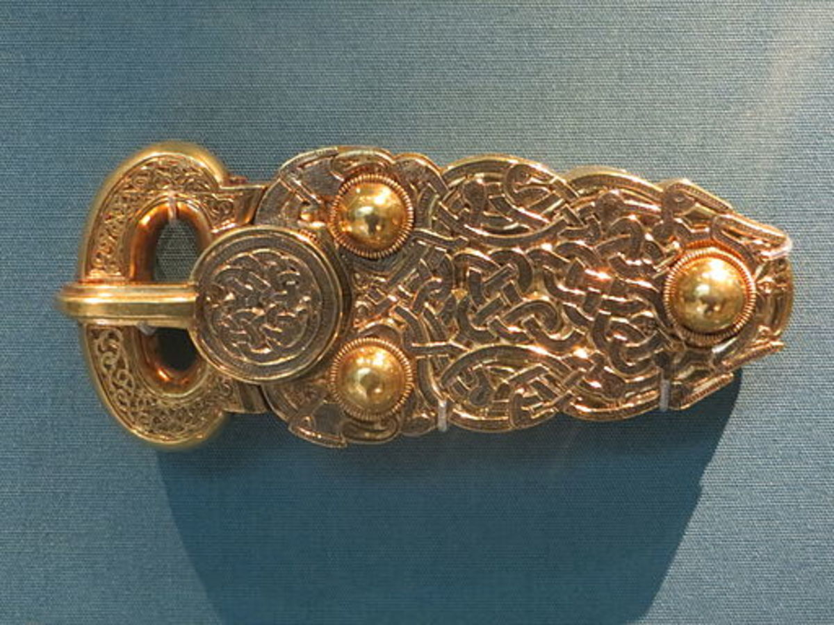 The gold belt buckle