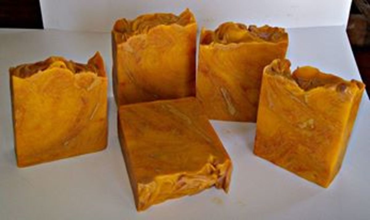 Red Palm Oil Soap swirled with Madder Root Powder, Red Clay, and Rose Clay. This batch was scented with a blend of Opium and Jasmine.