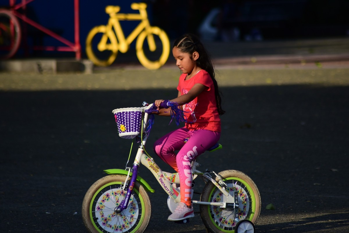 A girl and her first bike.