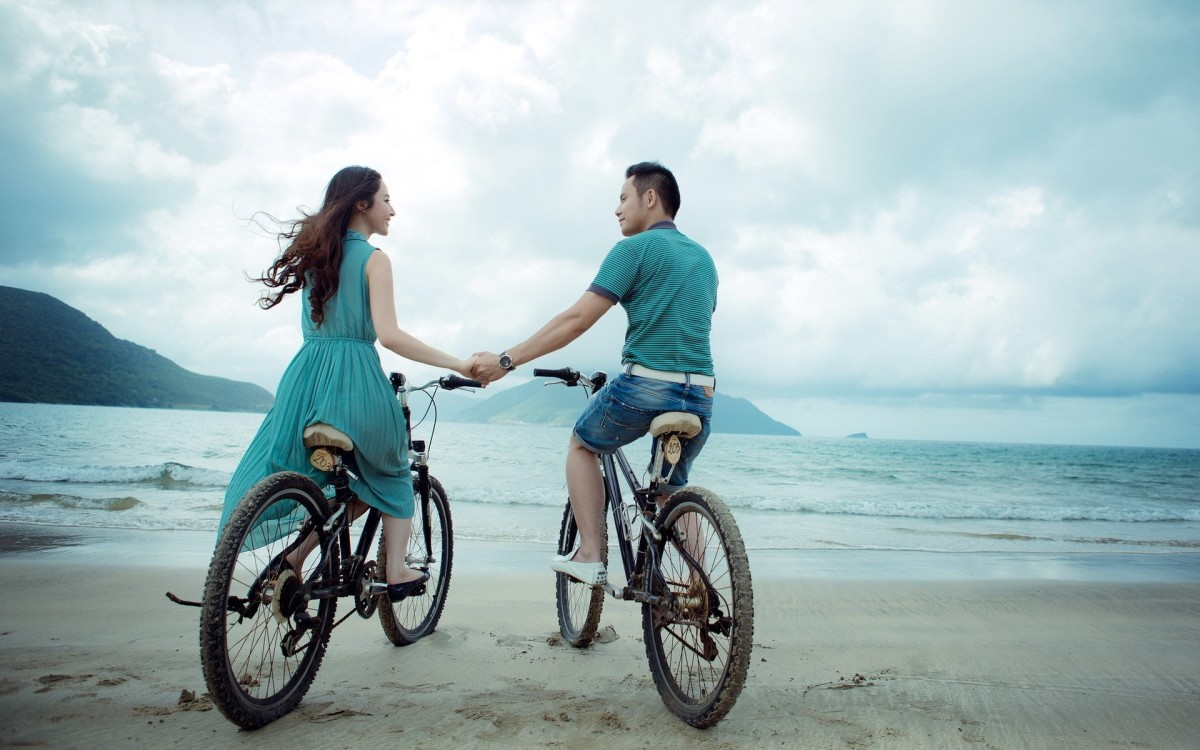 A couple taking a relaxing ride on their bikes.
