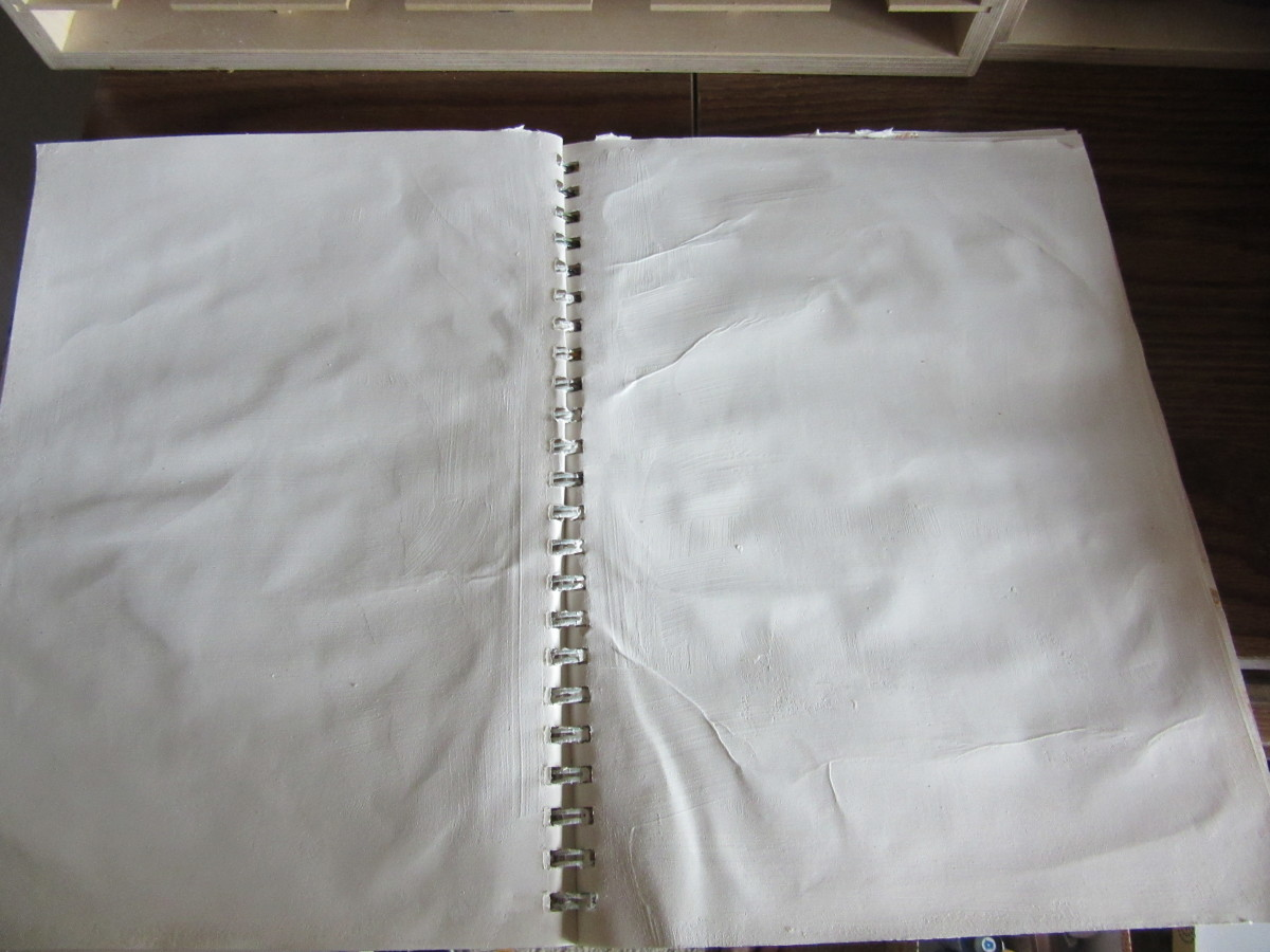 I used gesso on these pages then used Modge Podge to glue the page to the page behind it for extra strength. Wrinkles are OK. It adds a nostalgic feel. I will be adding some distress ink to make the pages look like old paper